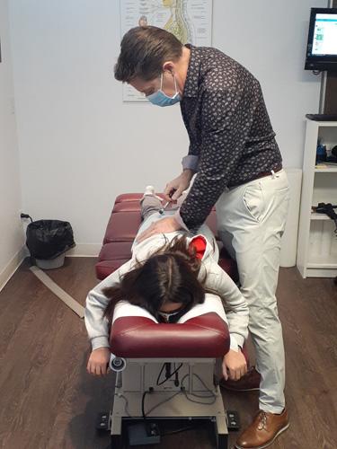 Chiropractor Calgary AB Brad Pritchard Adjusting Patient
